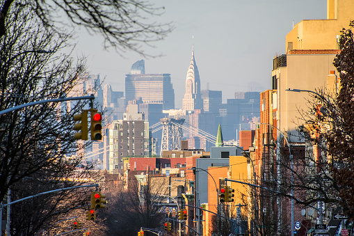 View of Manhattan from a Brooklyn street while riding in a car. New York City, New York.